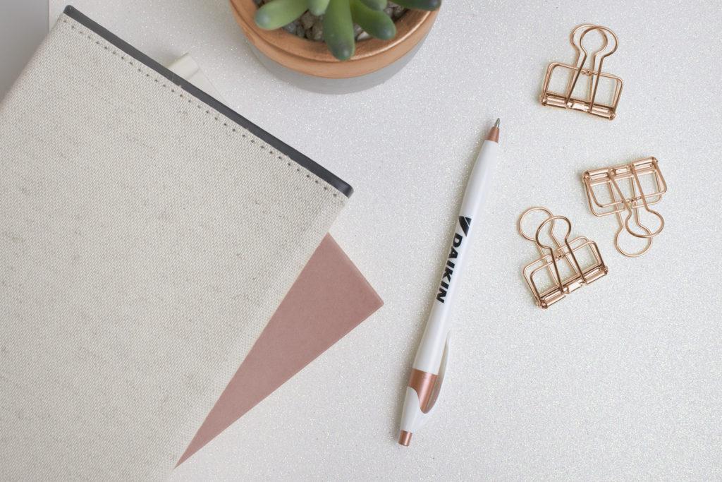 Javalina Shimmer Copper plastic promotional pen on a desk