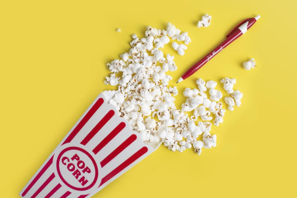 Javalina Executive red plastic promotinal pen and theater popcorn