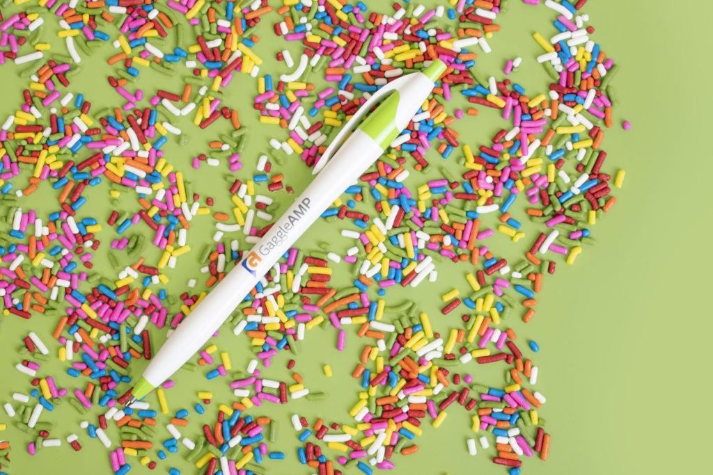 Javalina Splash plastic promotional pen on top of sprinkles