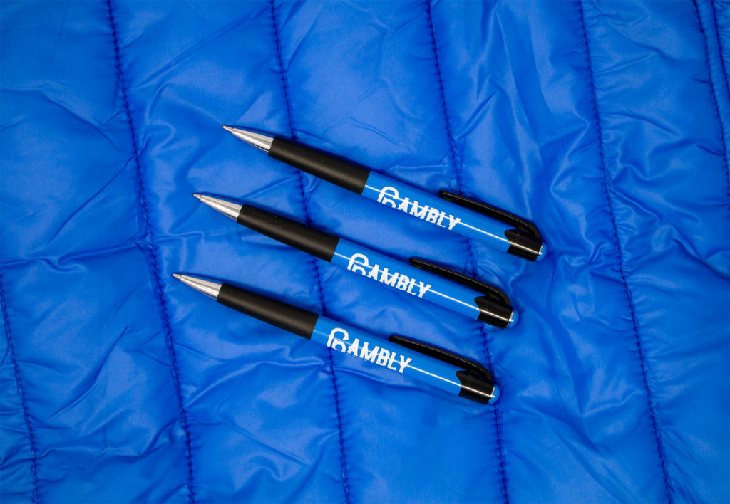 Mardi Gras blue promotional pens on a blue background