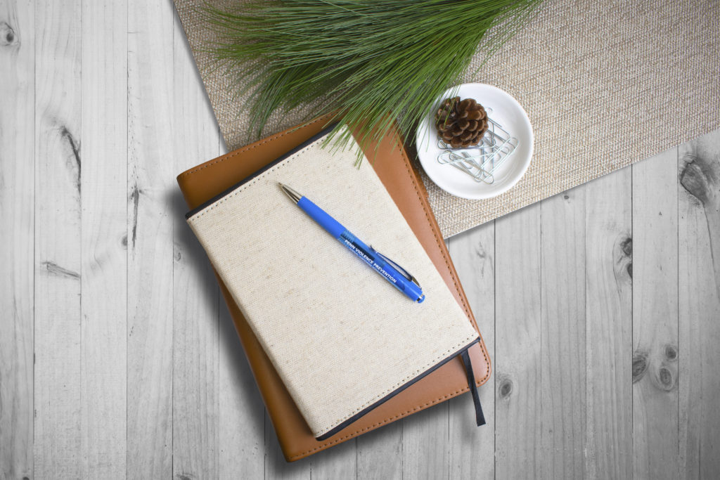 Mardi Gras Clipper blue promotional pen on wood table with pine