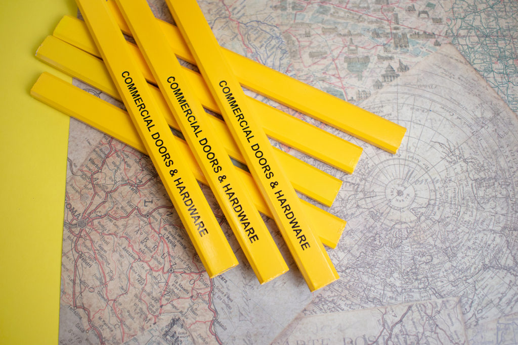 Yellow Carpenter promotional pencil with a travel theme