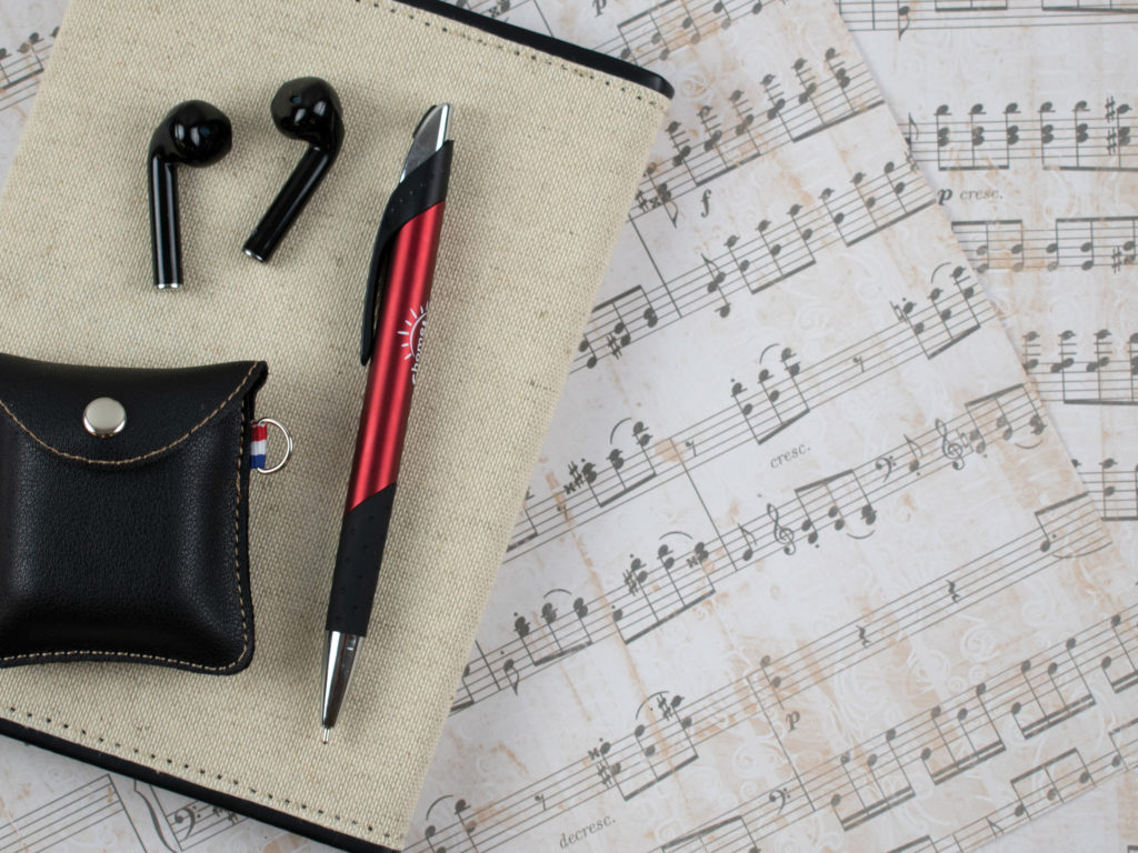 Crescendo promotional pen with ear buds and sheets of music