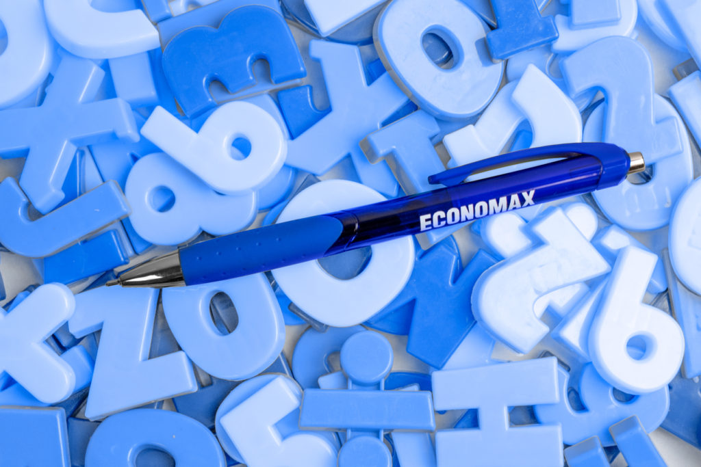 Zia blue promotional pen on top of alphabet and letter